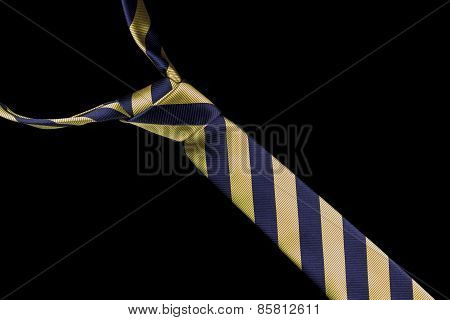 Necktie in silk with gold and blue stripes