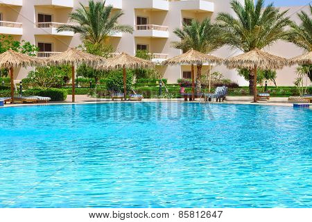 HURGHADA, EGYPT - APR 29, 2012: tropical swimming pool at Hilton Long Beach Resort Hotel in Hurghada