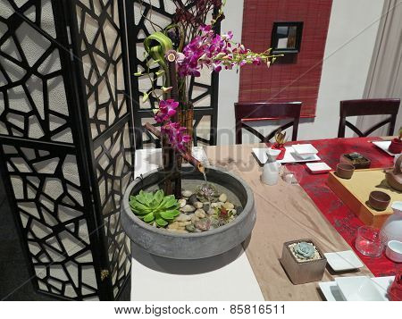 Decorative set design with flowers and furniture