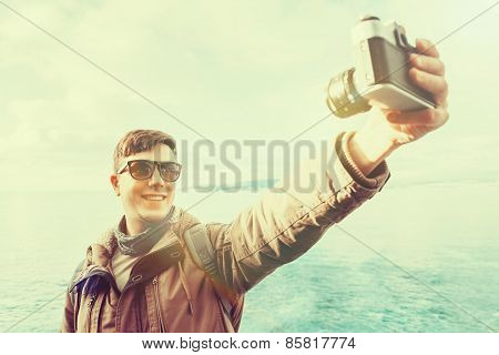 Happy Man Doing Self-portrait On Coastline