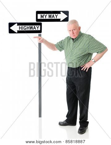 An angry senior man pointing the viewer to the left, the same way the