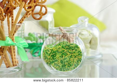 Composition for St Patrick Day with sweets on table close up