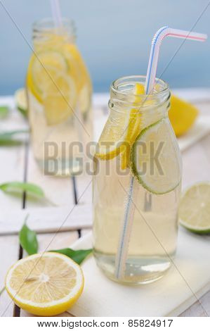 Fresh Cold Lemon Drink With Slices Of Lime And Lemon