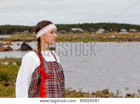 Girl In National Dress At The Sea Shore