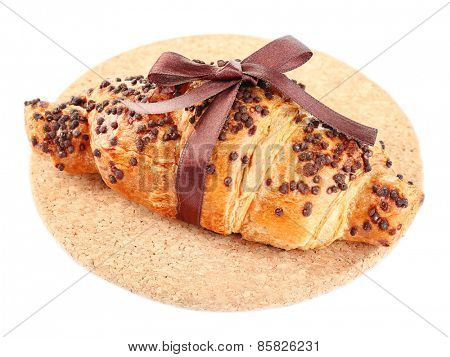 Fresh and tasty croissant with chocolate, isolated on white