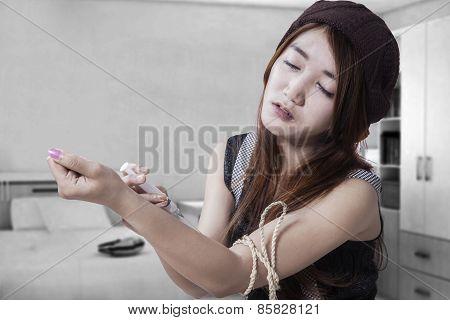 Drug Addict Teenage Girl With Syringe