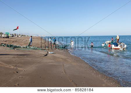 Fishermen Preparing Their Nets