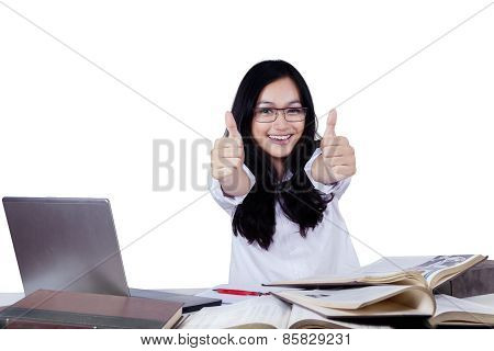 Happy Teenage Student With Thumbs Up