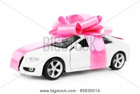New car with pink bow as present isolated on white