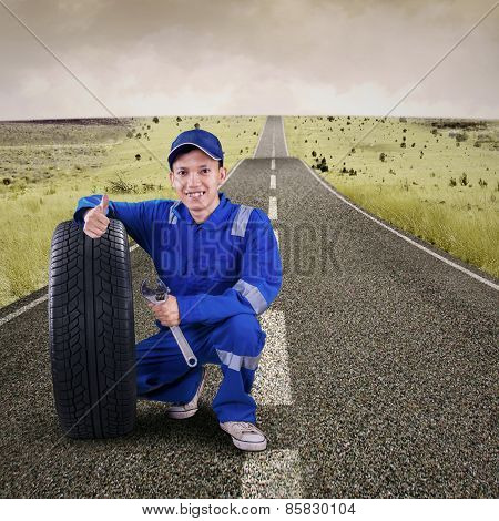 Mechanic Showing Thumb Up On The Road