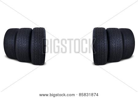 Six Black Tires Isolated On White