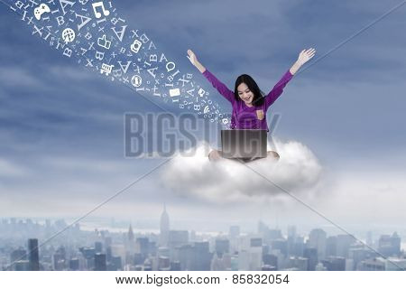 Student Sitting On The Cloud With Laptop