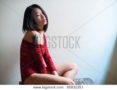 Beautiful Sensual Asian Woman Posing Thoughtful Red Bodysuite