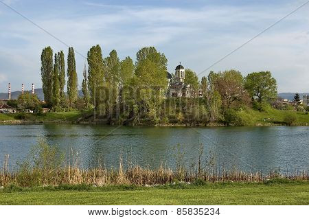 Lake and church in garden at quarter Drujba