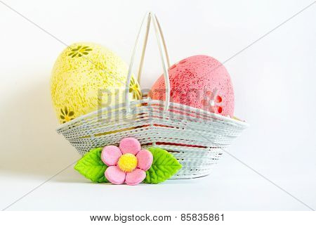 Yellow And Pink Easter Eggs In A Basket With Pink Flower