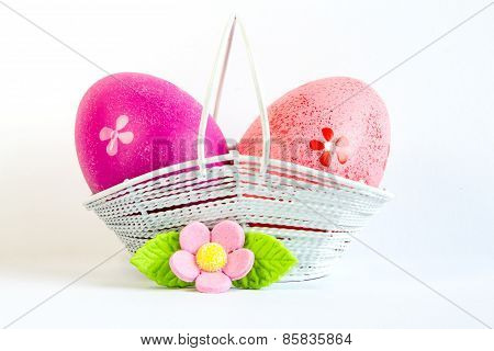 Crimson And Pink Easter Eggs In A Basket With Pink Flower
