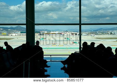 BARCELONA AIRPORT, SPAIN - MAR 16 2015 : Passengers wait at the Gate for a departing flight.