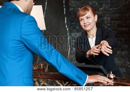 Guest communicating with a receptionist
