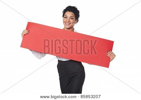 Happy businesswoman holding banner