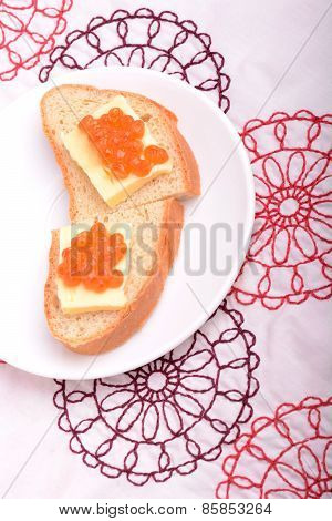 Sandwich With Red Caviar On White Plate