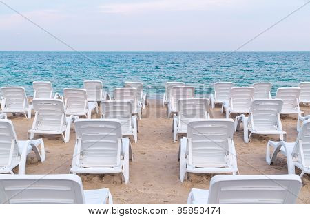 Sun Loungers On The Sand Sea Beach.