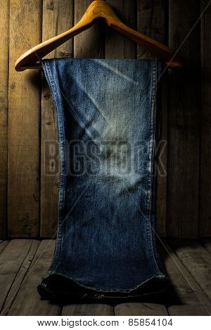 Blue Jean With Wood Hanger On Wood Background, Low Key Image