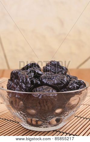 Prunes in a glass bowl