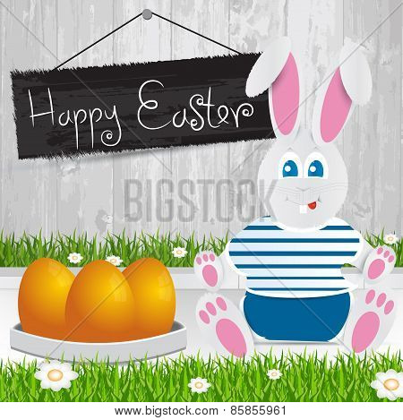 Easter Bunny. Happy Easter . Orange Easter Eggs.the Grass With A Wooden Fence And Flowers.