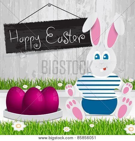 Easter Bunny. Happy Easter . Purple Easter Eggs.the Grass With A Wooden Fence And Flowers.
