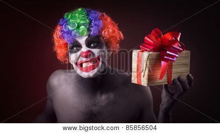 scary clown makeup and with a terrible gift