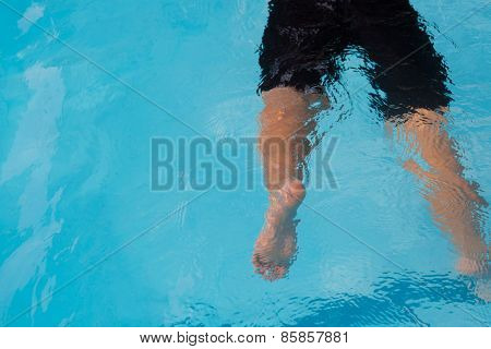 Legs of drowning boy.