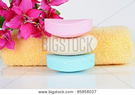 Colored Soap Bars, Yellow Towel, Pink Flowers
