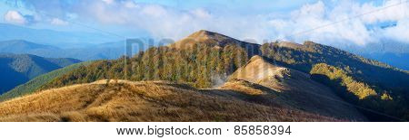Autumn landscape. Mountain panorama. Forest on the slopes