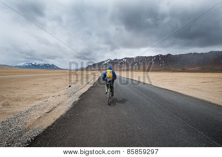 Rider on Himalayan Road