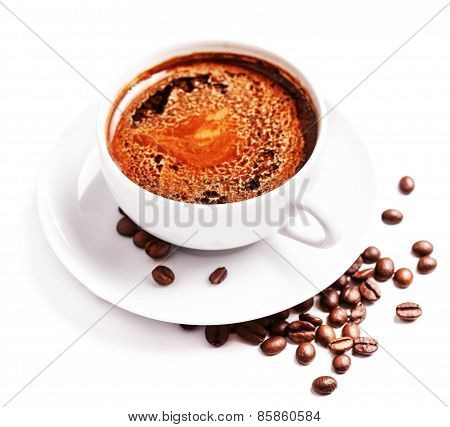 Coffee Cup And Saucer With Roasted Coffee Beans Isolated On A White Background, Close Up