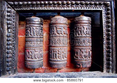 Three Tibetan Prayer Wheels Carved With Symbols - Vintage Effect.