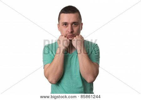 Man Looks Happily Folded Hands Near The Mouth