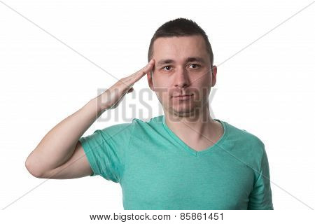 Young Man Saluting Isolated On White Background