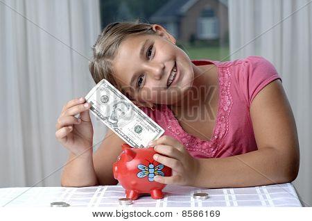 Muchacha de la escuela y billetes de un dólar