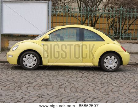 Yellow Volkswagen New Beetle