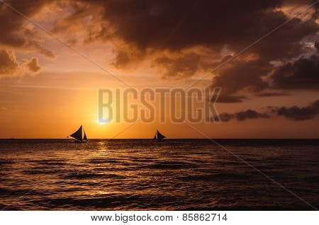 Silhouette Of Sailing Boats Against A Beautiful Sunset On Boracay