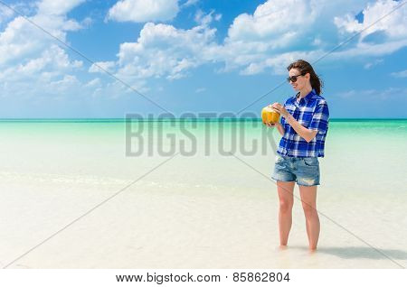 Young Cute Woman With Coconut At Tropical Sandy Beach In The Caribbean Sea