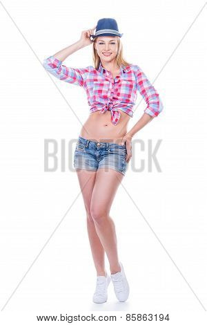Funky Beauty. Full Length Of Beautiful Young Woman In Funky Wear Adjusting Her Hat And Looking At Ca