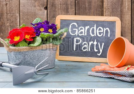 Blackboard On A Plant Table With The Text Garden Party