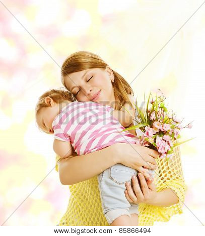 Mother And Baby Family Portrait With Flowers, Little Kid Embracing Mom, Child Congratulate Mother