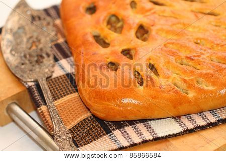 Barmy Meat Pie On A Towel And A Board