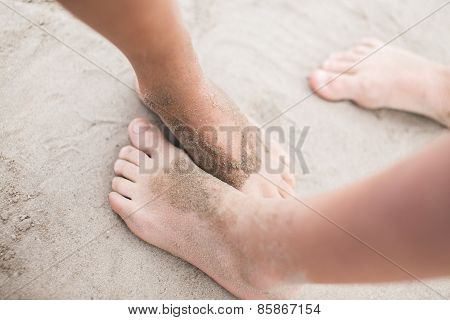 Toddler feet on sand at the beach