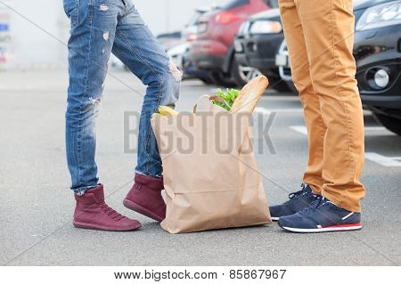 Couples Foot And Shopping Bag With Food
