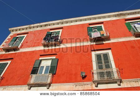 Italy. Campania Region. Procida Island. Mediterranean Ochre House Facade