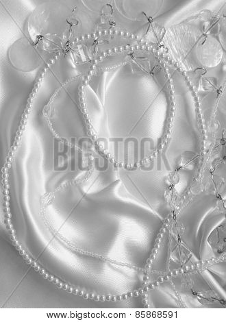 White Pearls And Nacreous Beeds On White Silk Or Satin As Wedding Background